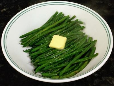 green beans on plate with butter