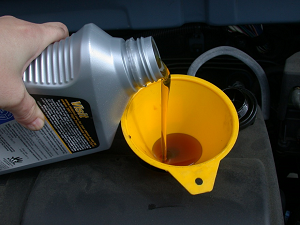 Lubricant-Pouring-in-Funnel